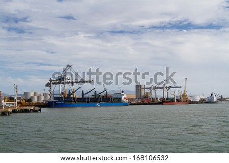 Cranes and ship in Townsville harbour, Australia - stock photo