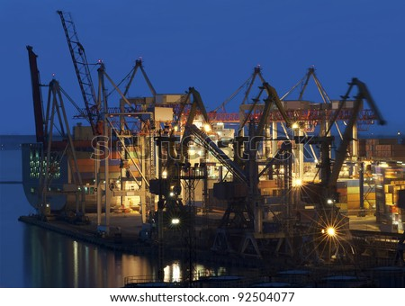 cranes at the container port terminal in Odessa sunset time - stock photo