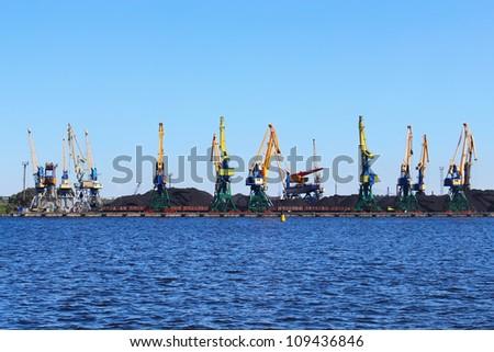 Cranes in the coal loading dock - stock photo