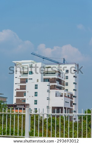 Cranes is used in the construction of tall buildings. - stock photo