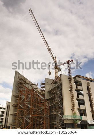 cranes looming over a large construction site