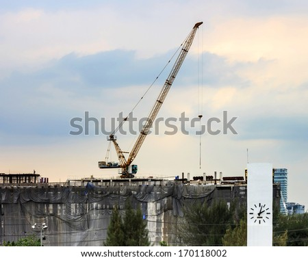 Cranes on a construction site - stock photo