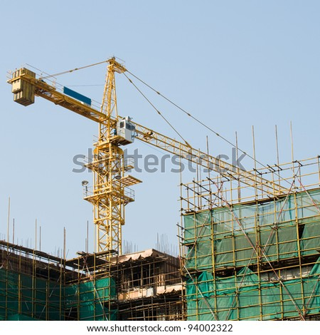 Cranes on a construction site in China. - stock photo