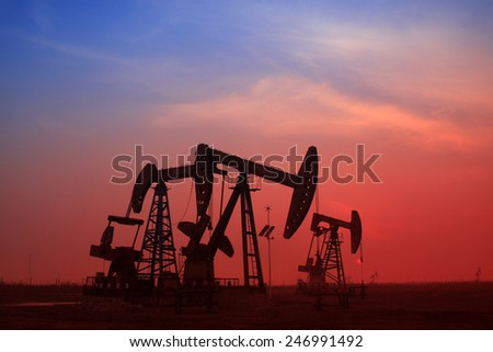 crank balanced beam pumping unit in a oilfield, China - stock photo