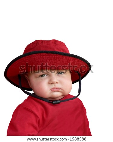 Cranky baby in red hat. - stock photo
