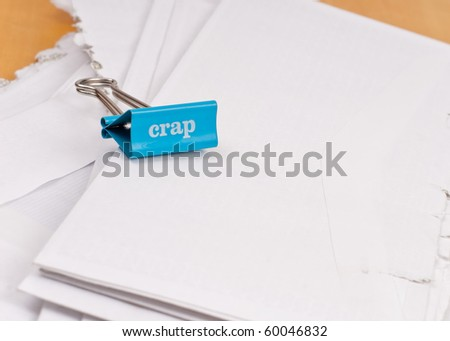 Crap Note Clip on Mail Pile - stock photo