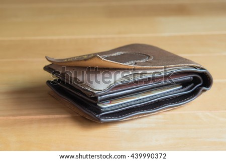 crash wallet on on wooden table for finance and banking concept