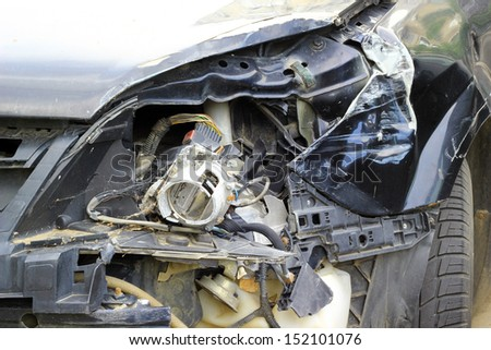 Crashed car close up. The front part is severely damaged. - stock photo