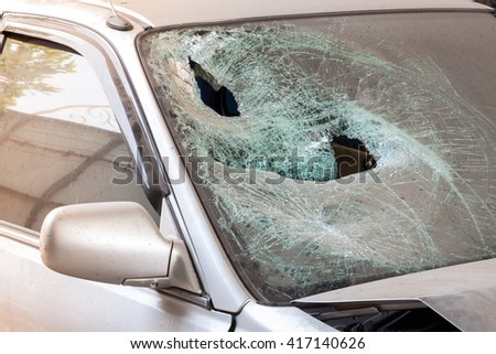 Crashed car with broken windshield, transportation accident - stock photo
