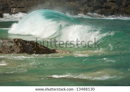 Crashing Wave on the Na Pali Coast, Kauai - stock photo