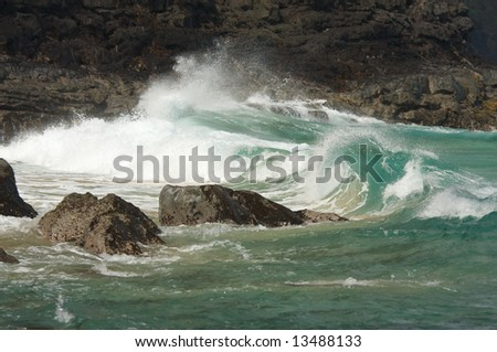 Crashing Waves on the Na Pali Coast, Kauai - stock photo