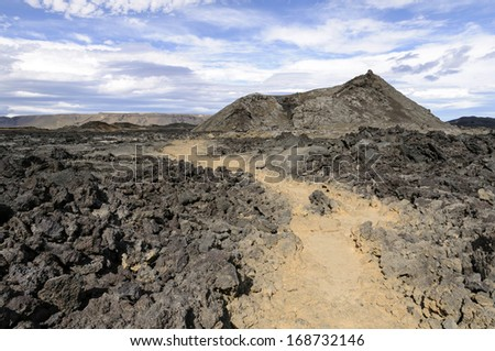 Crater and lava field in Krafla caldera - This is a caldera of about 10 km in diameter with a 90 km long fissure zone, in north of Iceland.  There have been 29 reported eruptions in recorded history. - stock photo