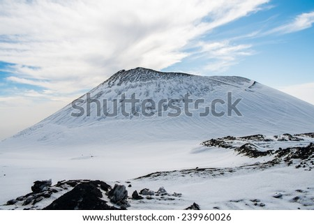 Crater around mount Etna with snow, Sicily, Italy - stock photo
