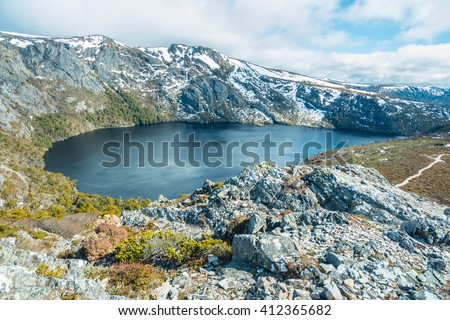 Crater lake in Cradle mountain national park of Tasmania, Australia. - stock photo