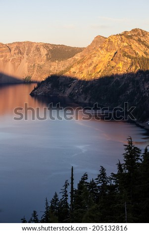 Crater Lake National Park in Oregon is one of the most scenic areas in the Pacific Northwest. The lake is the deepest in North America at over 1900 feet deep. - stock photo