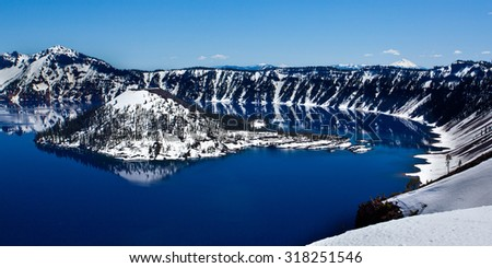 Crater Lake Sun and Snow - stock photo