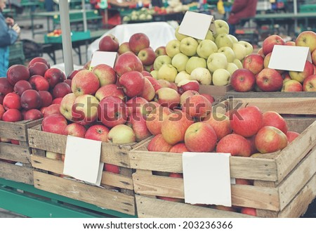 Crates of apples on the market - stock photo