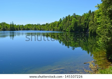 Crawford Lake, one of the few Meromictic lakes around the world,  highlight of the Crawford Lake Conservation Area, south of Milton, Ontario Canada - stock photo