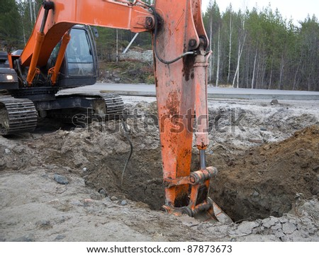 Crawler excavator working on the roadside