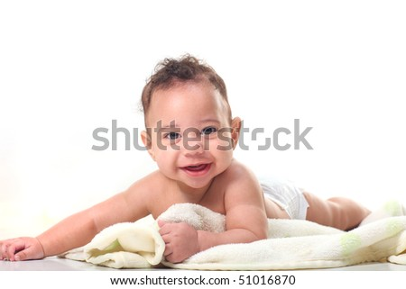 Crawling Baby Boy on Stomach With Blankets on White Background - stock photo