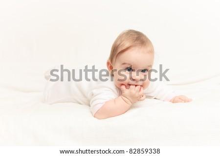Crawling baby on white background - stock photo