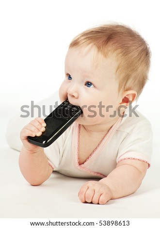 Crawling baby with mobile phone on the floor