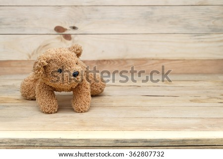 crawling brown teddy bear. - stock photo