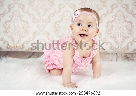 Crawling little baby girl - stock photo
