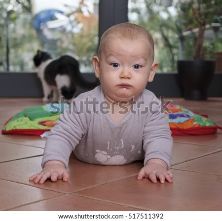 Crawling newborn male child portrait