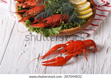crayfish cooked with fresh herbs and lemon on the table close-up. horizontal
