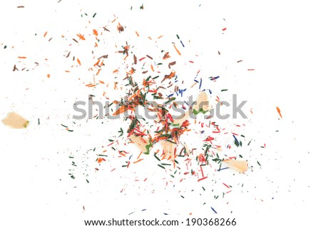Crayon shavings on white background - stock photo
