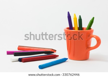 crayons full color with small cup for the child. - stock photo