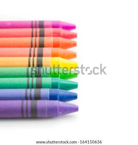 Crayons in beautiful color spectrum, Tips aligned straight. Isolated on white.  - stock photo