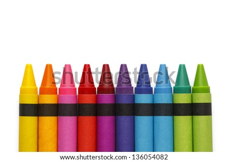 Crayons lined up in rainbow isolated on white background. - stock photo