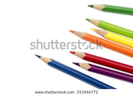 crayons or colored pencils isolated on a white background with copy space - stock photo