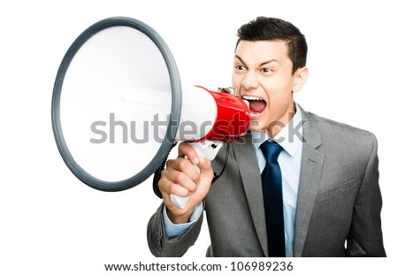 Crazy Asian businessman screaming in megaphone on white background - stock photo