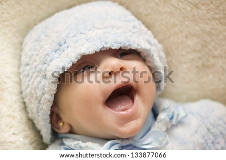 Crazy baby. Baby laughing happy in sofa. - stock photo