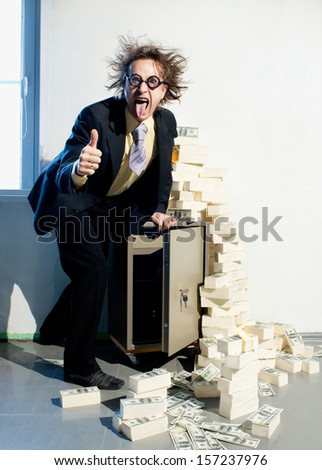 Crazy banker with bunch of money - stock photo