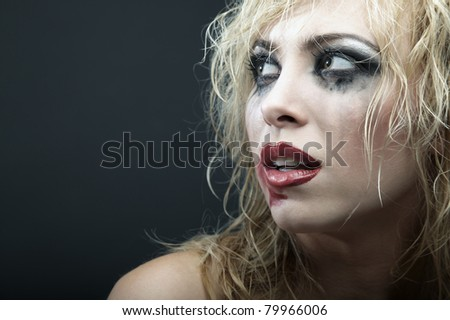 Crazy blond lady with bizarre makeup. Horizontal portrait - stock photo