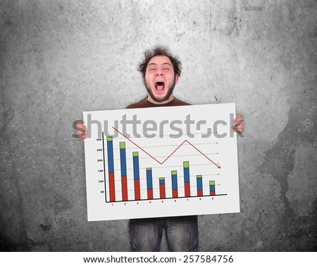 crazy businessman holding poster with decreasing chart - stock photo