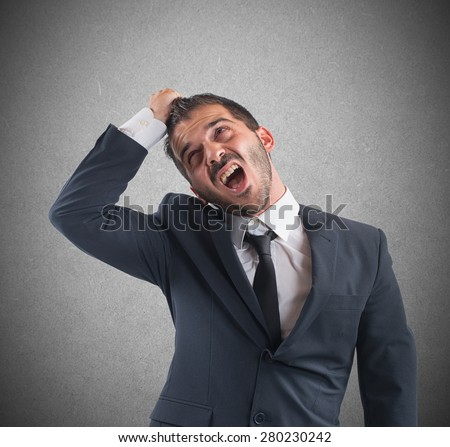 Crazy businessman stressed out from work screams - stock photo