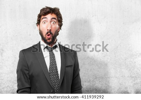 crazy businessman surprised expression - stock photo
