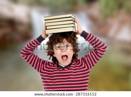 Crazy child with books on his head shouting - stock photo