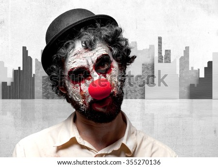 crazy clown man angry expression - stock photo