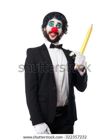 crazy clown man with pencil - stock photo