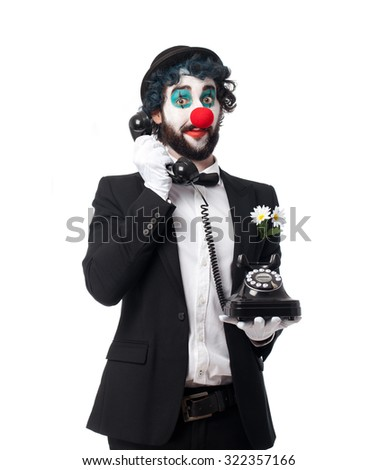 crazy clown man with telephone - stock photo