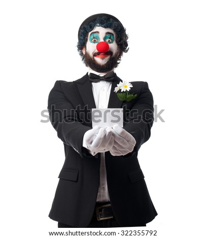crazy clown man with visit card - stock photo