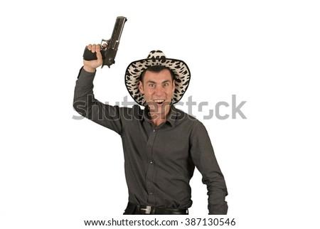 Crazy cowboy holding a gun - stock photo