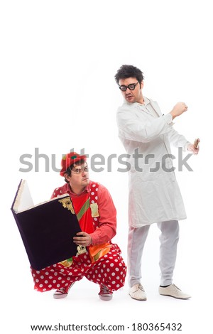 crazy doctor and a clown with a magic book on white background