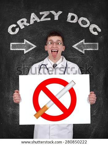crazy doctor holding poster with no smoking symbol - stock photo